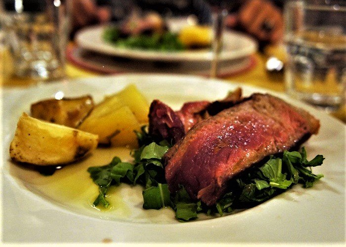 Florentine steak with garnish. Florence, Italy