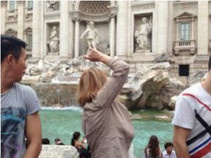 Throwing Coins in the Trevi Fountain