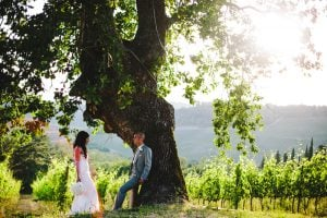 just married African American couple by a big tree