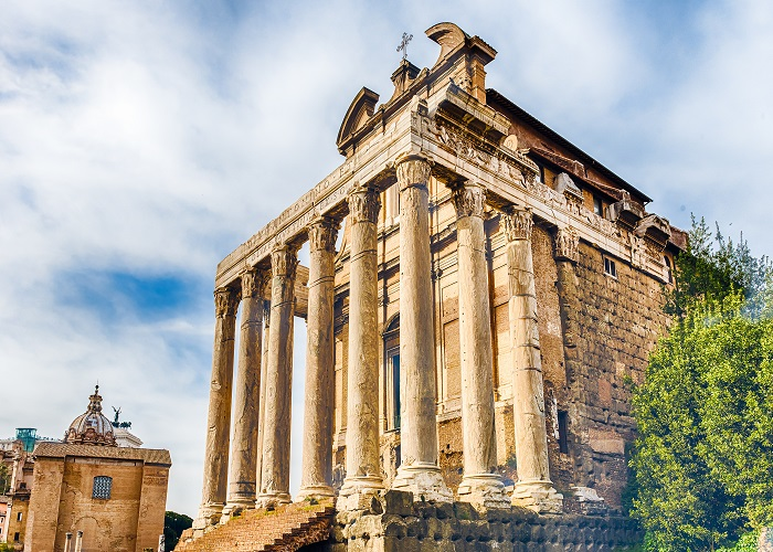 Ancient ruins of the Temple of Antoninus and Faustina inside the Roman Forum in Rome, Italy