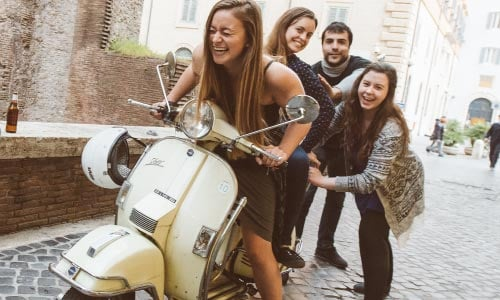 about us pushing a vespa to craft the best experiences in Rome