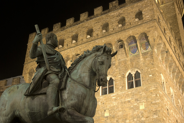 Cosimo de'Medici Statue with Palazzo Vecchio behind it. Florence, Italy