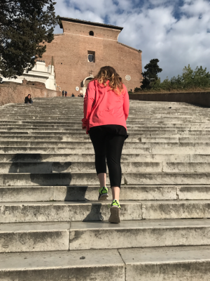 travel fit and healthy in rome hannah running up marble stairs